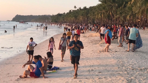 Philippine island once called 'cesspool' reopens to tourists