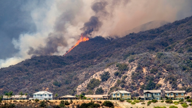 California firefighters scramble to keep flames from