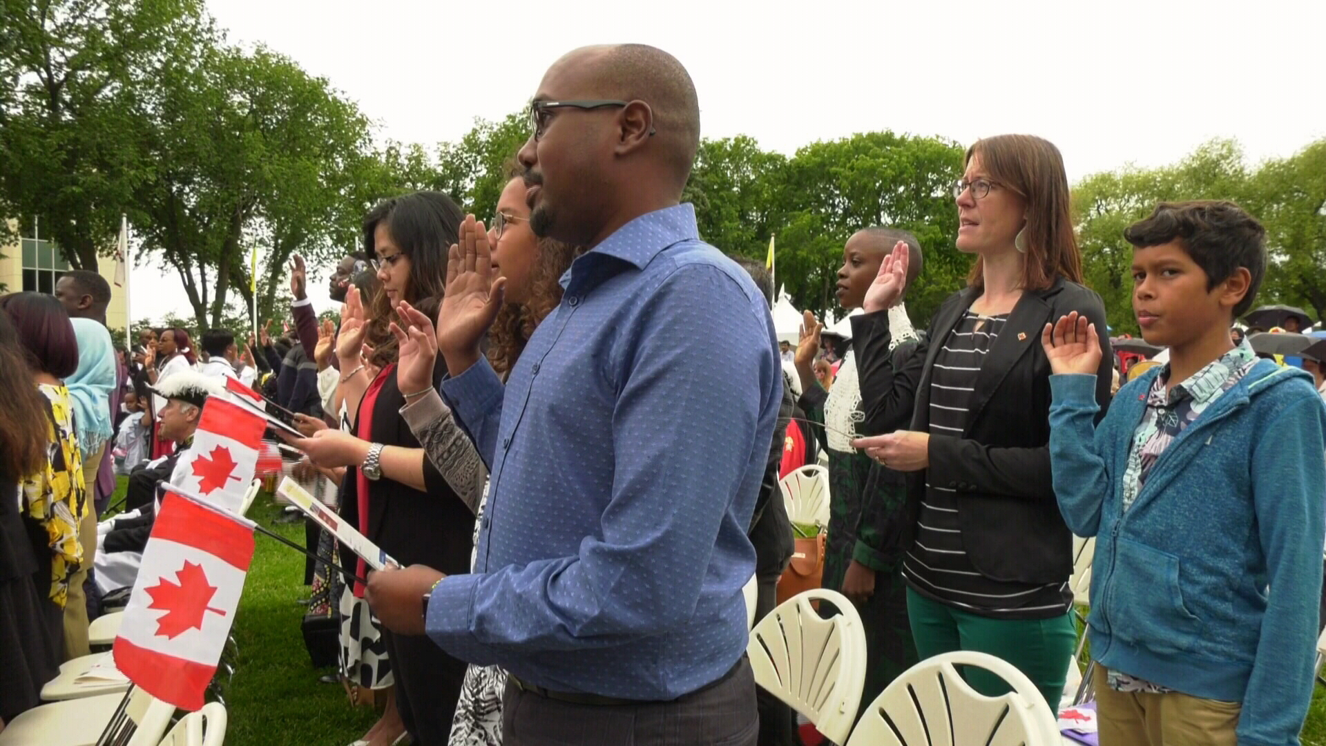 I marvel at the greatness of it': New Canadians take oath on