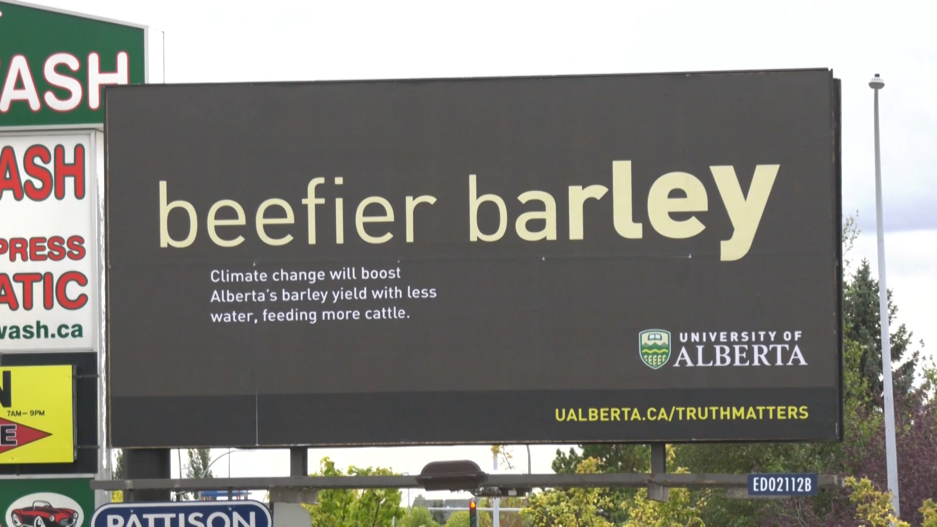 Billboard touting the benefits of climate change appears in