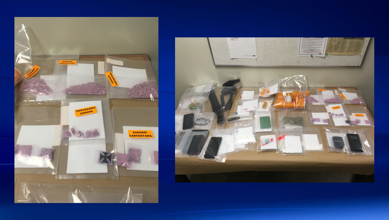 Two charged after drugs and weapons seized during traffic stop in