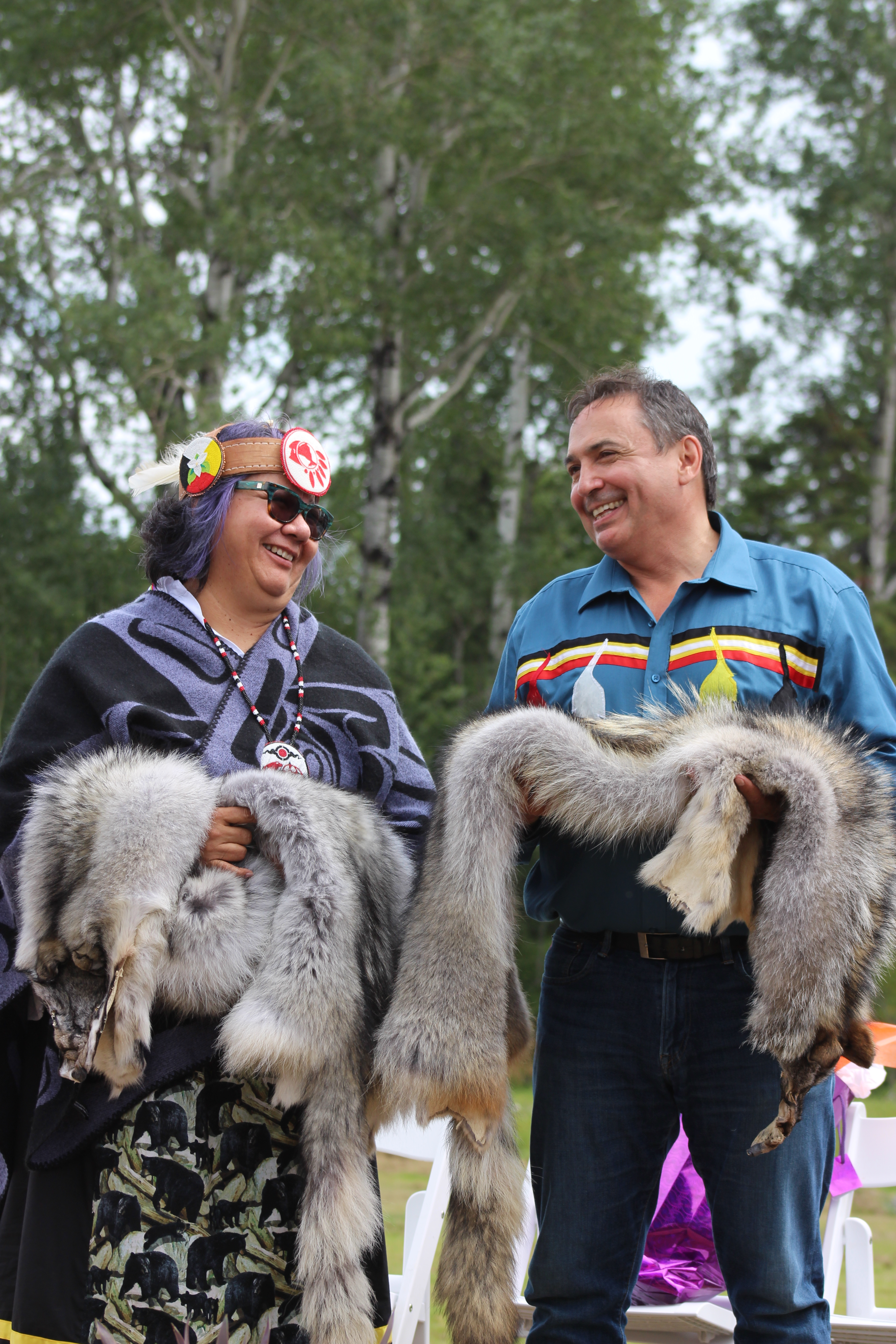 Ontario Regional Chief Rose-Anne Archibald and National Chief of the Assembly of First Nations Perry Bellegarde accept gifts during the Giizis Energy Celebration at KZA-GBFN. Photo: Katelyn Thomas
