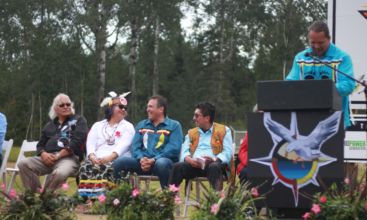 KZA Councillor Kevin King, Ontario Regional Chief Rose-Anne Archibald, National Chief of the Assembly of First Nations Perry Bellegarde and KZA Chief Wilfred King share a laugh during the Giizis Energy Celebration. Photo: Marissa Ramnanan