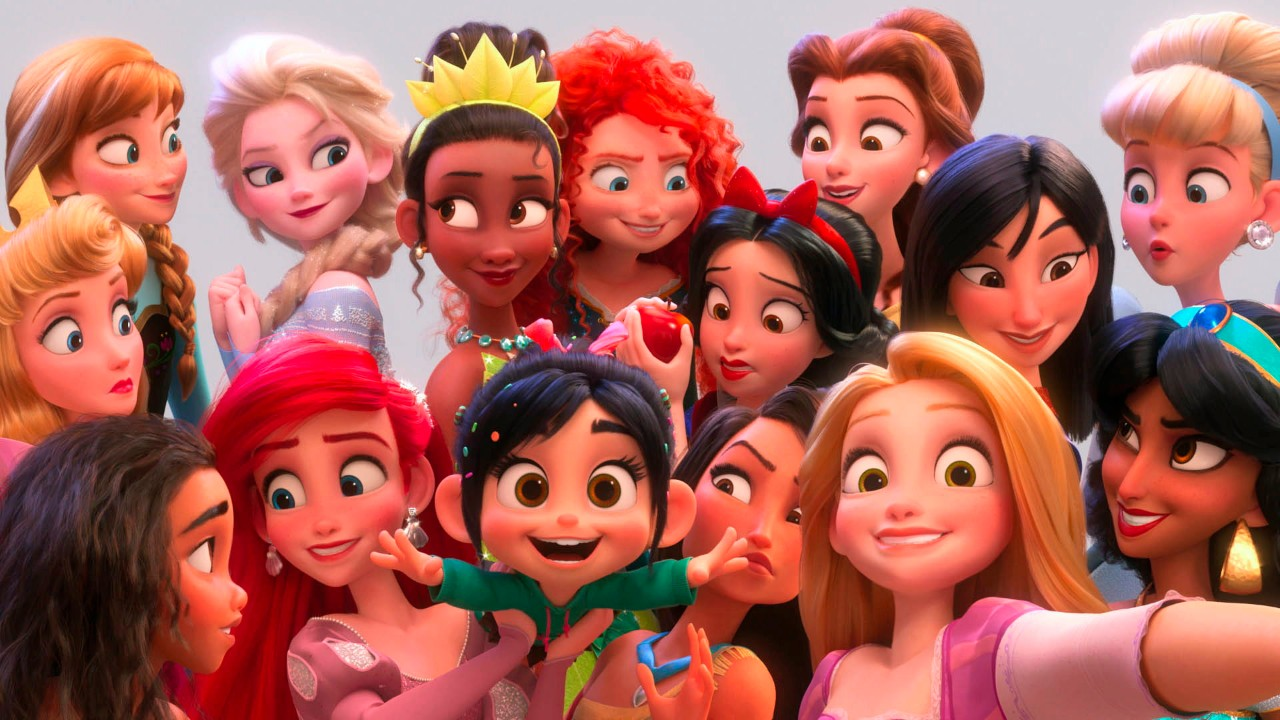The character Vanellope von Schweetz posing with Disney princesses in a scene from 'Ralph Breaks the Internet.' (Disney via AP)