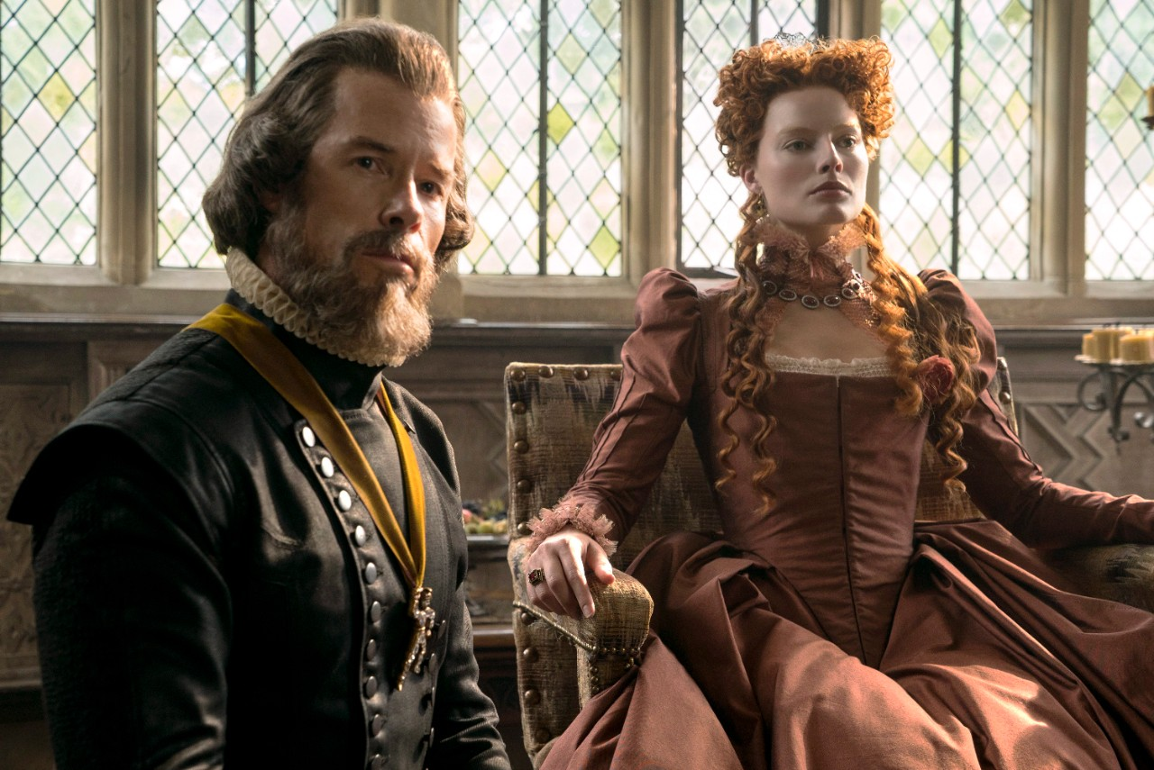 Guy Pearce as William Cecil, left, and Margot Robbie as Queen Elizabeth in 'Mary Queen of Scots.' (Liam Daniel / Focus Features via AP)