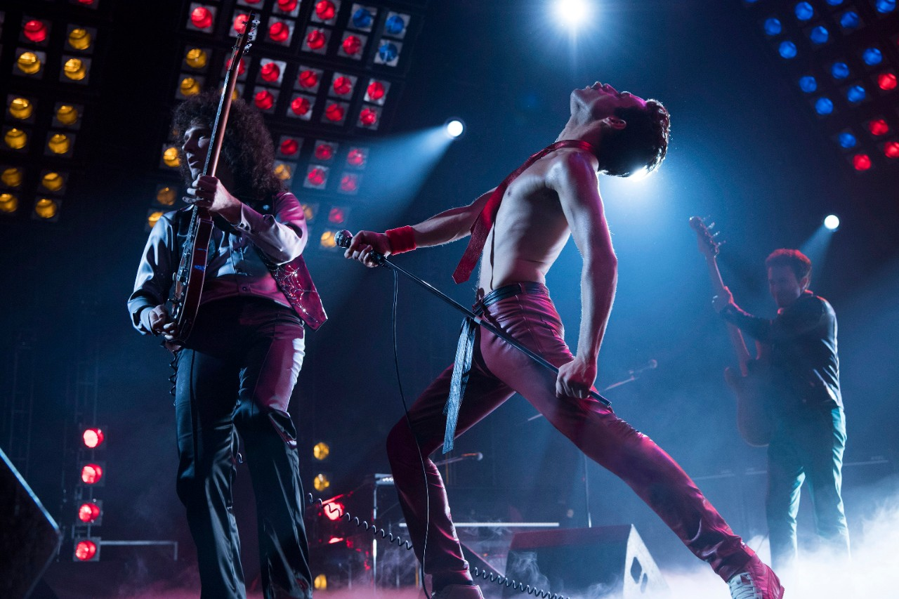 Gwilym Lee, from left, Rami Malek and Joe Mazzello in a scene from 'Bohemian Rhapsody.' (Alex Bailey / Twentieth Century Fox via AP)