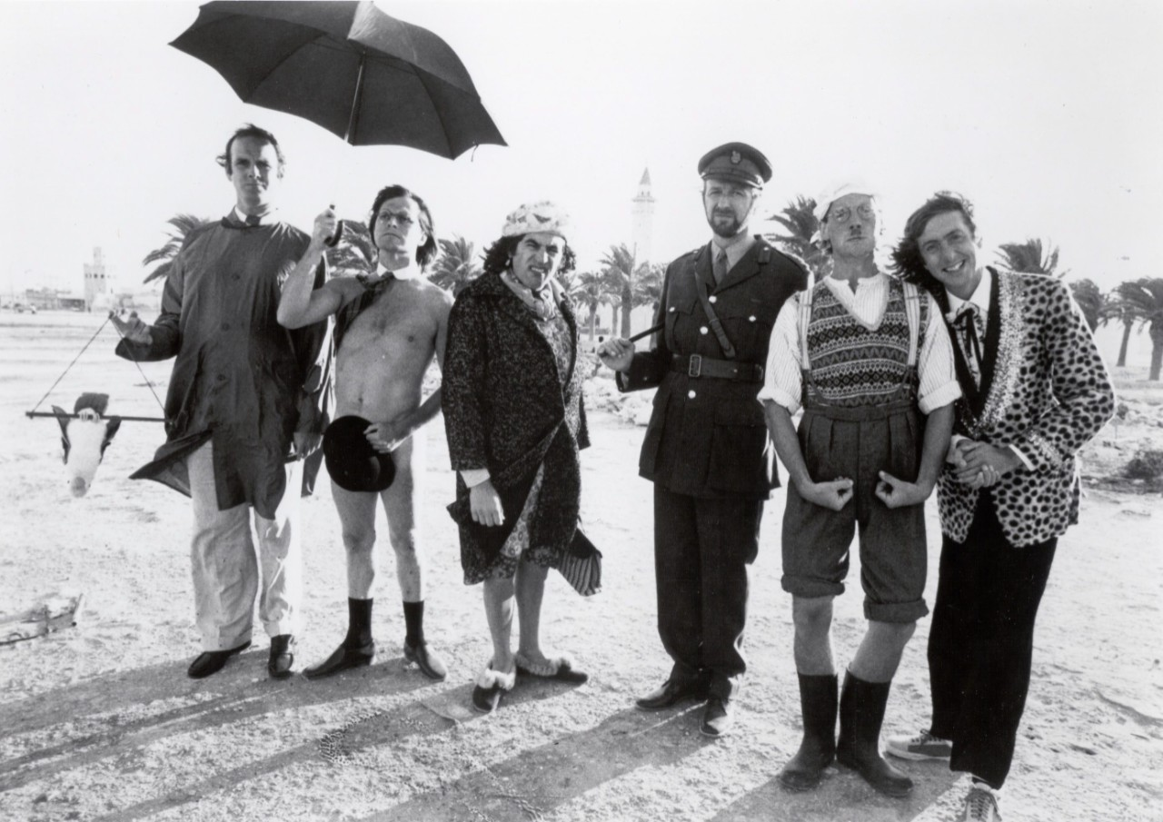 "In this publicity photo released by PBS, cast members of the original ""MontyPython's Flying Circus"" line up on a beach. From left: John Cleese, Terry Gilliam, Terry Jones, Graham Chapman, Michael Palin and Eric Idle."